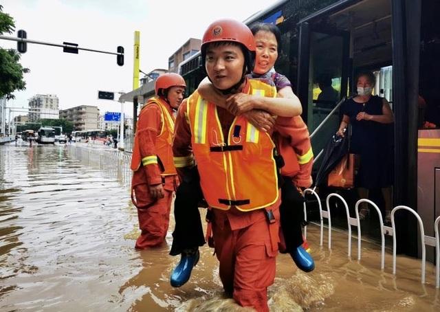 Lũ lụt kinh hoàng ảnh hưởng tới 14 triệu dân tại Trung Quốc - 3