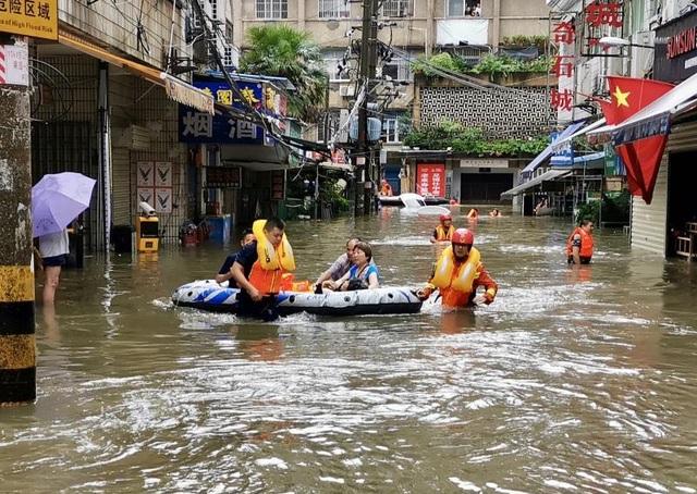 Lũ lụt kinh hoàng ảnh hưởng tới 14 triệu dân tại Trung Quốc - 4