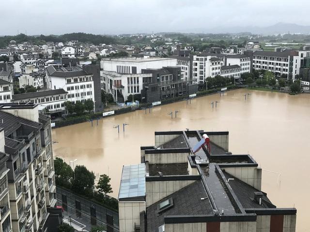 Trung Quốc nâng cảnh báo mưa lũ mức cao nhất ở hạ nguồn đập Tam Hiệp - 3