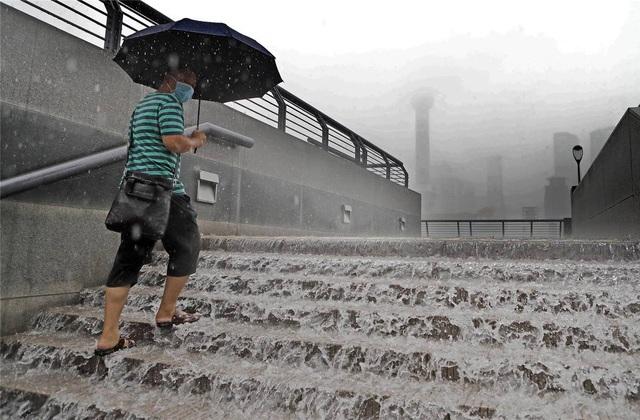 Trung Quốc nâng cảnh báo mưa lũ mức cao nhất ở hạ nguồn đập Tam Hiệp - 5