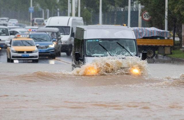 Trung Quốc nâng cảnh báo mưa lũ mức cao nhất ở hạ nguồn đập Tam Hiệp - 1