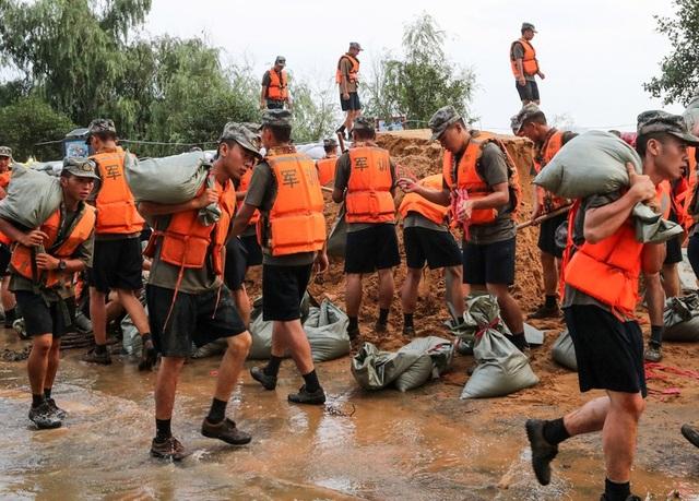 Lũ lụt nghiêm trọng nhất 3 thập kỷ tàn phá nhiều tỉnh thành ở Trung Quốc - 5