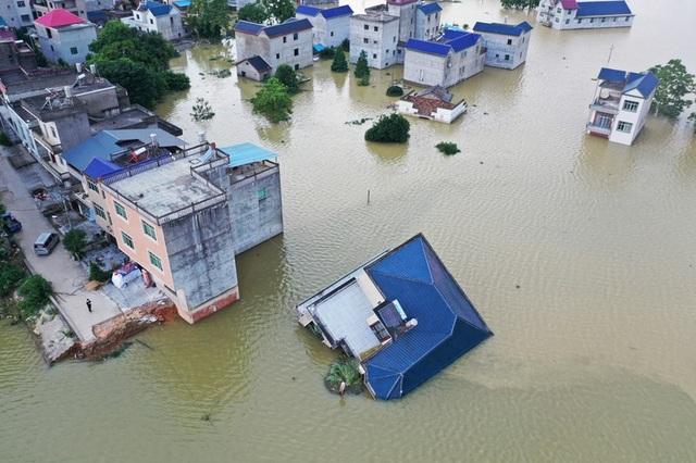 Lũ lụt nghiêm trọng nhất 3 thập kỷ tàn phá nhiều tỉnh thành ở Trung Quốc - 7