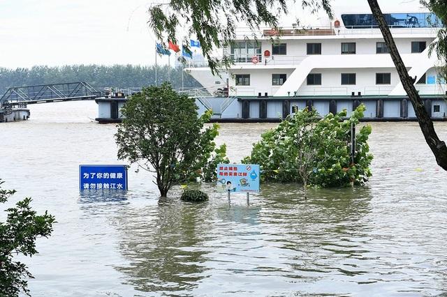 Lũ lụt nghiêm trọng nhất 3 thập kỷ tàn phá nhiều tỉnh thành ở Trung Quốc - 8