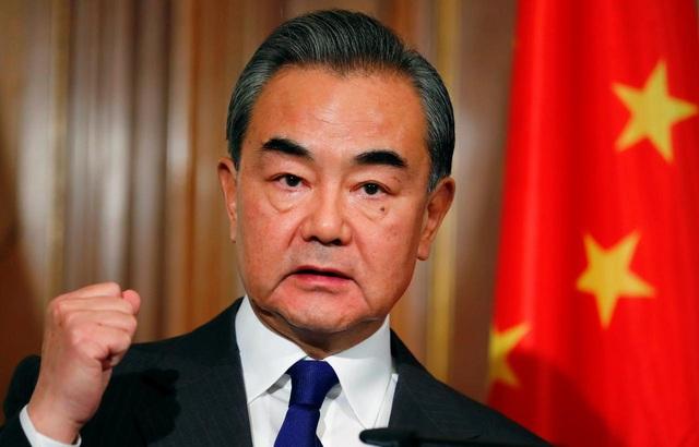 Ngoại trưởng Trung Quốc nói Mỹ mất trí - 1