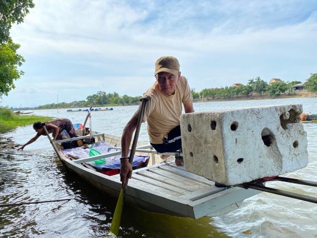 Thương binh hạng 1/4 làm giàu từ nuôi cá, thu lãi 100 triệu đồng/năm - 2