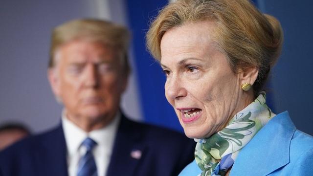 Ông Trump bác cảnh báo Covid-19 lây lan bất thường ở Mỹ - 1