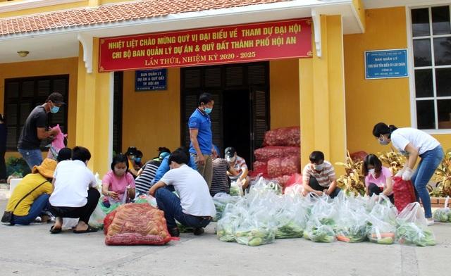 Hội An: Đi từng ngõ, gõ từng nhà, trao thực phẩm đến hộ dân cách ly - 1