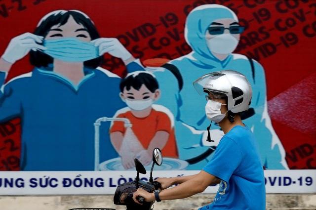 Chuyên gia quốc tế: Việt Nam phản ứng nhanh và mạnh với đợt bùng dịch mới - 1