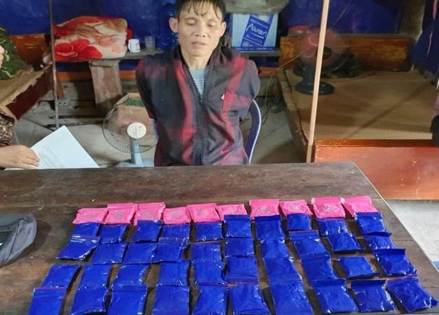 Dùng xuồng máy đưa ma túy từ Lào vượt sông vào Việt Nam - 2