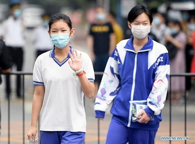 Bắc Kinh tuyên bố mở lại trường học - 1