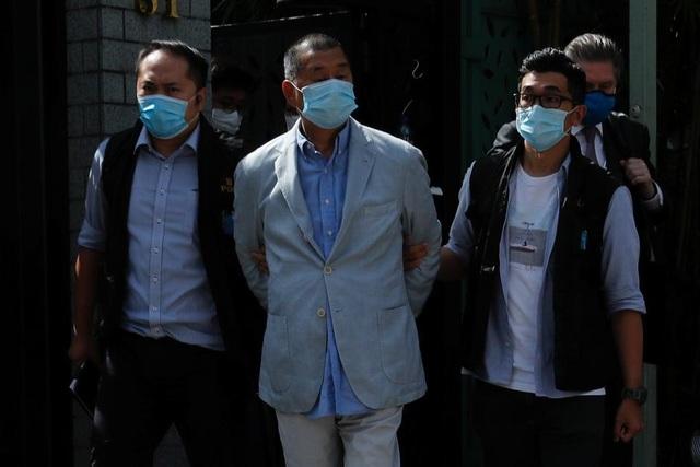 Mỹ, Anh lên tiếng về việc Hong Kong bắt giữ ông trùm truyền thông - 1
