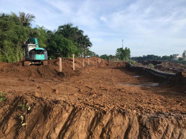 Giám đốc Sở Nông nghiệp chỉ đạo xử lý vụ thuê máy múc đào phá đê - 1