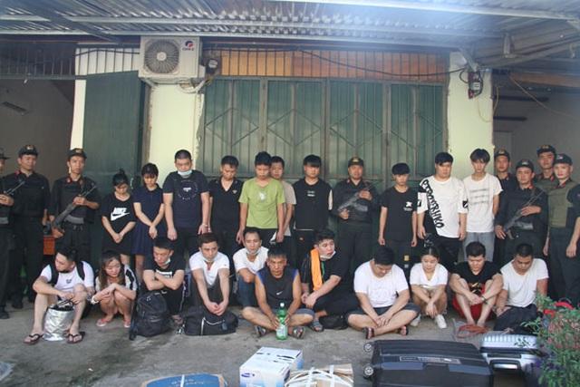 Bắt giữ ổ nhóm 21 người Trung Quốc bị truy nã đang lẩn trốn tại Lào Cai - 1