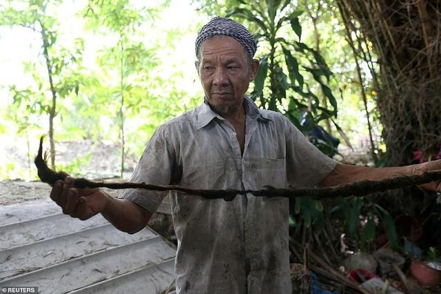 Dị nhân Việt Nam 80 năm không cắt tóc lên báo quốc tế - 5