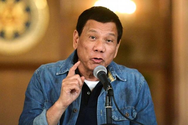 Philippines vẫn hợp tác với công ty Trung Quốc xây đảo nhân tạo trái phép - 1