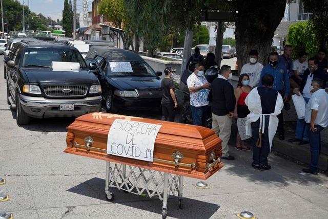 Mexico cạn kiệt giấy chứng tử giữa lúc số ca Covid-19 tăng vọt - 1