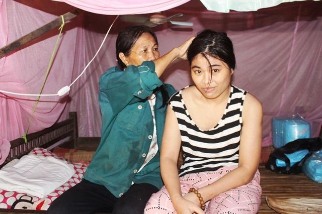 Bạn đọc Dân trí giúp đỡ cha mẹ nghèo nuôi hai con bị bại liệt - 2