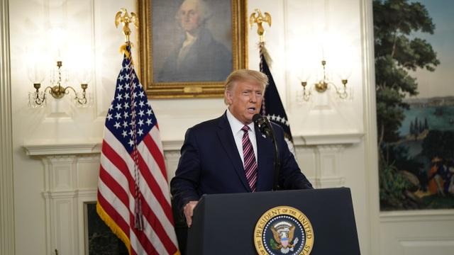 Sách mới chỉ trích ông Trump che giấu đại dịch Covid-19 - 1