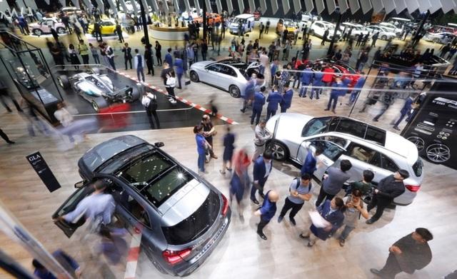 Triển lãm ô tô lớn nhất Trung Quốc tái khởi động trong bất an - 1