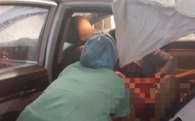 Nữ tài xế taxi giúp sản phụ sinh thành công trên xe trong bão - 1