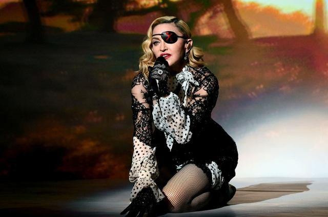 Madonna sẽ làm phim về ngày giông bão nhất trong đời - 4