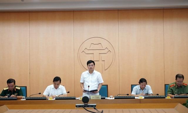 Chủ quan trong phòng chống Covid-19, 6 quận huyện ở Hà Nội bị phê bình - 1
