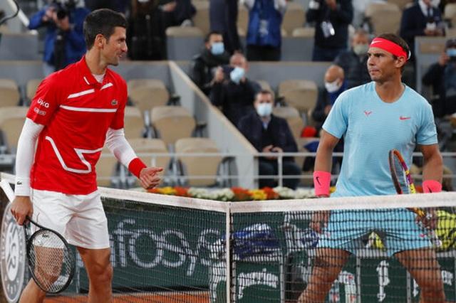 Những khoảnh khắc Nadal đánh bại Djokovic, lập chuỗi kỷ lục mới - 1