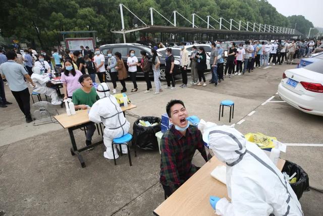 Trung Quốc xét nghiệm Covid-19 toàn thành phố 9 triệu dân - 1
