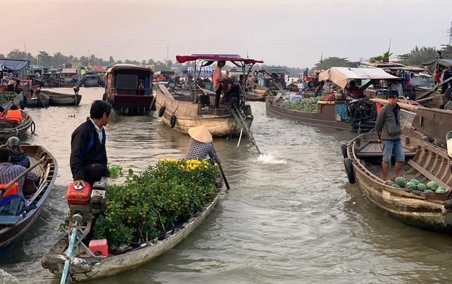 Trên 70% khách du lịch đến Cần Thơ đã tham quan chợ nổi Cái Răng - 2