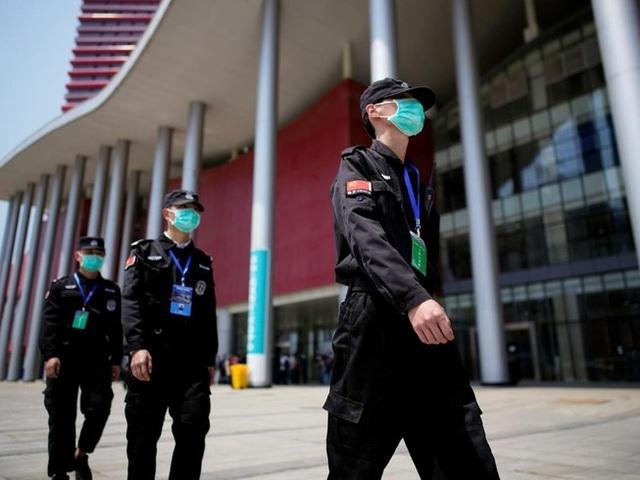 Trung Quốc cảnh báo bắt giữ công dân Mỹ giữa lúc căng thẳng - 1