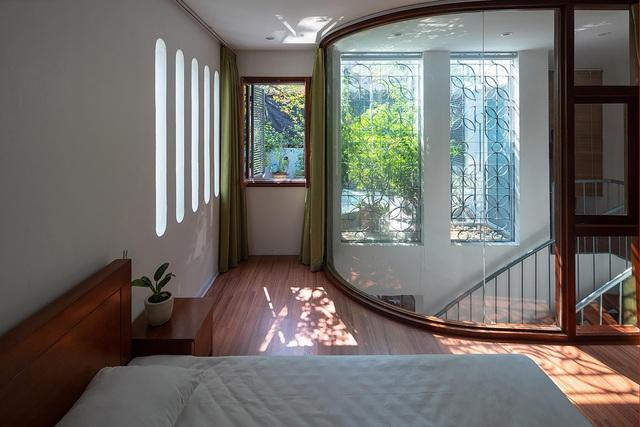 Căn biệt thự trắng có mặt tiền cong độc đáo, nổi bật nhất khu phố ở Hà Nội - 8