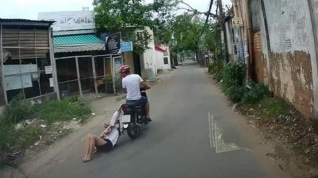 Tên cướp kéo lê cô gái hơn 500m trên đường phố Sài Gòn - 2