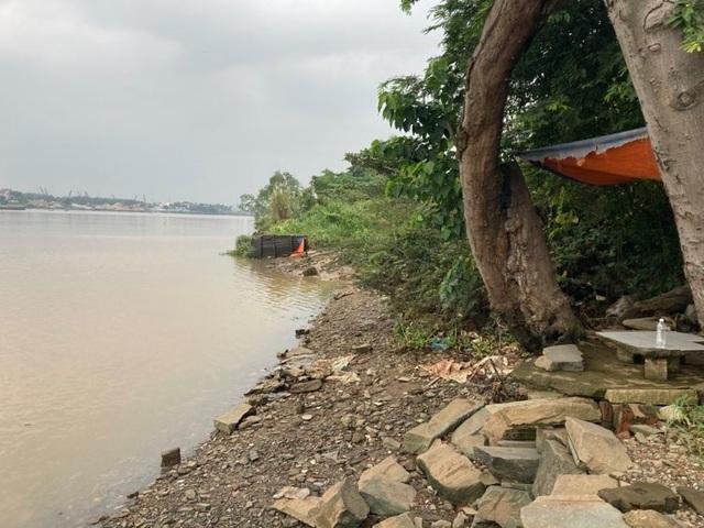 Đi câu cá phát hiện thi thể người trôi trên sông - 1