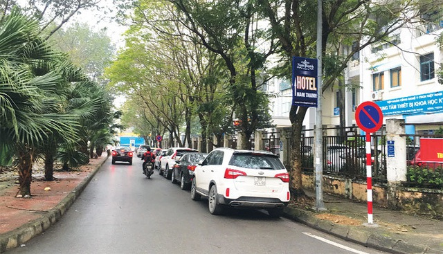 Ở thành phố, dừng đỗ xe thế nào để không bị phạt? - 1