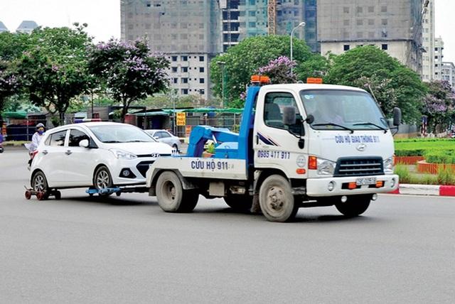 Chủ phương tiện vi phạm có được mặc cả phí cẩu, kéo xe không? - 3