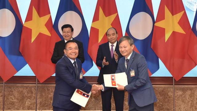 EVN ký loạt hợp đồng mua điện từ các công trình nguồn có qui mô lớn của Lào - 1