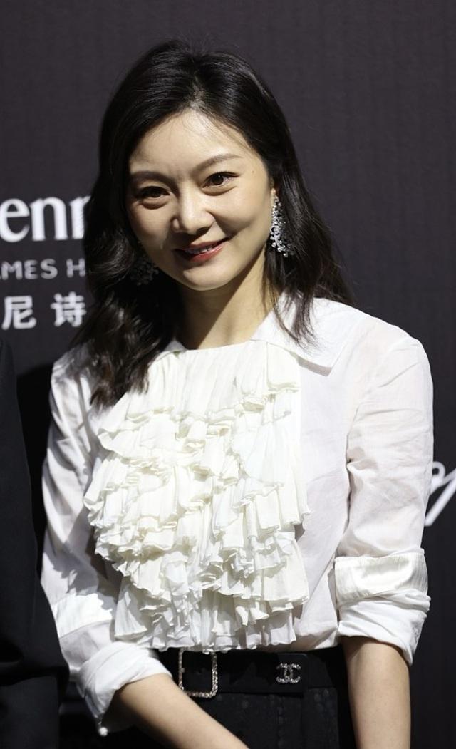 Cuộc hôn nhân kín tiếng của Trương Nghệ Mưu bên người vợ kém 31 tuổi - 10