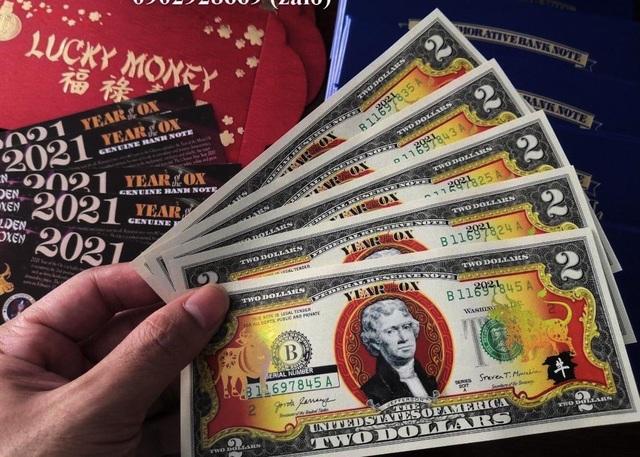 Cầu may bằng hàng ngoại: Đổi 300.000 đồng lấy tờ 2 USD in hình trâu - 1
