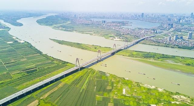 Cần hoàn thiện cơ sở pháp lý để triển khai con đường ven sông Hồng - 1