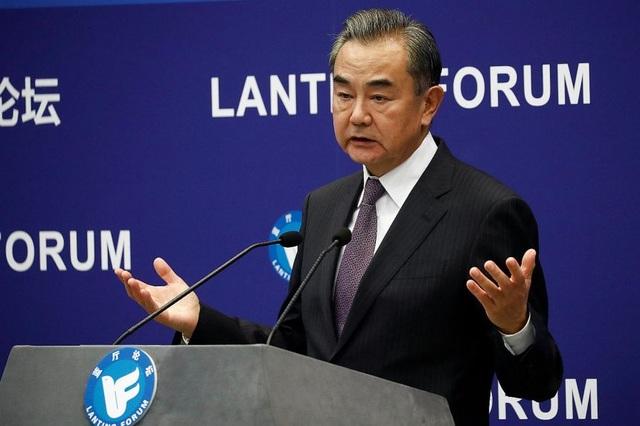 Mỹ dồn dập giáng đòn, Trung Quốc kêu gọi đối thoại - 1