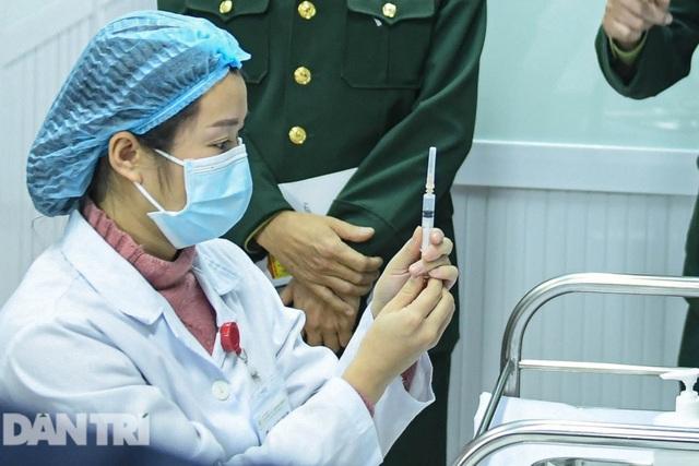 60-70% người tiêm phản ứng nhẹ với vắc xin Covid-19 Việt Nam - 1