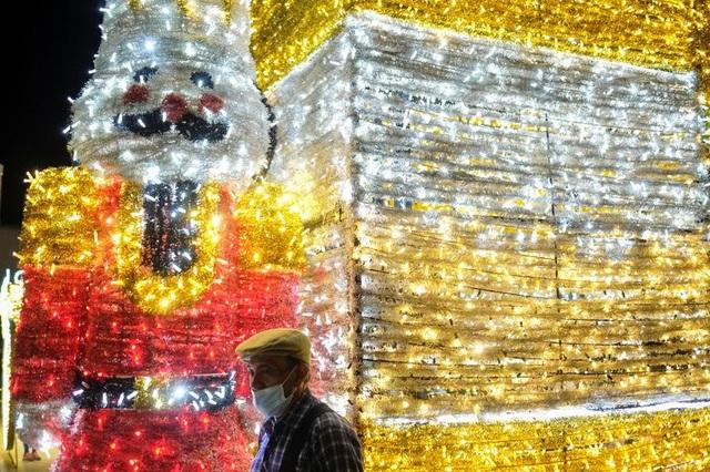 Thế giới đón Giáng Sinh trong bóng ma Covid-19 - 10