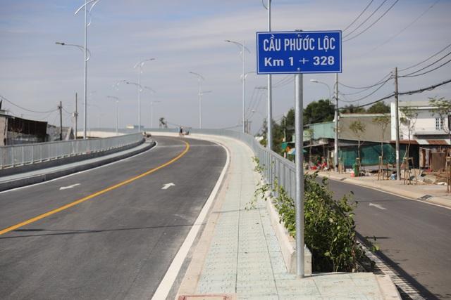 Dân vùng ven Sài Gòn háo hức chờ cây cầu xây 8 năm mới xong - 7