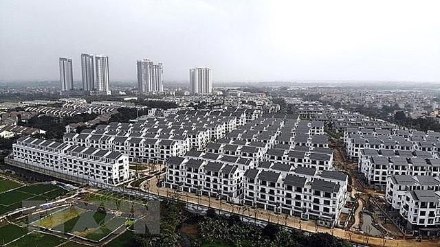 Thị trường bất động sản Việt Nam: Lò xo bị nén chặt chờ bật dậy - 1
