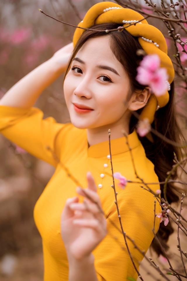 Nữ sinh Báo chí xúng xính áo dài đón Xuân sang - 1