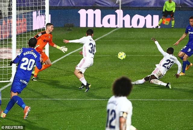 Đánh bại Getafe, Real Madrid chỉ còn kém Atletico 5 điểm - 3