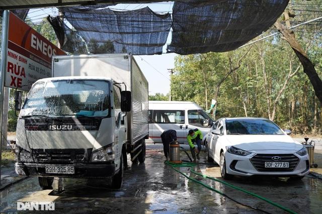 Dịch vụ rửa xe ở Hà Nội hốt bạc dịp Tết Nguyên đán, giá tăng cao gấp 4 lần - 11