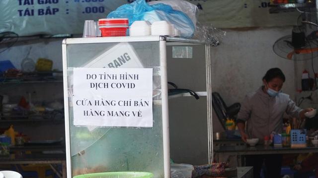 Loa phường nhắc nhở, hàng quán ở Hà Nội lắp vách ngăn, bán mang về - 6