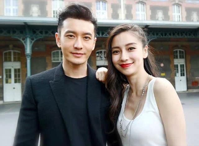 Huỳnh Hiểu Minh lộ ảnh đi bar với gái trẻ, Angelababy hôn má trai lạ - 2